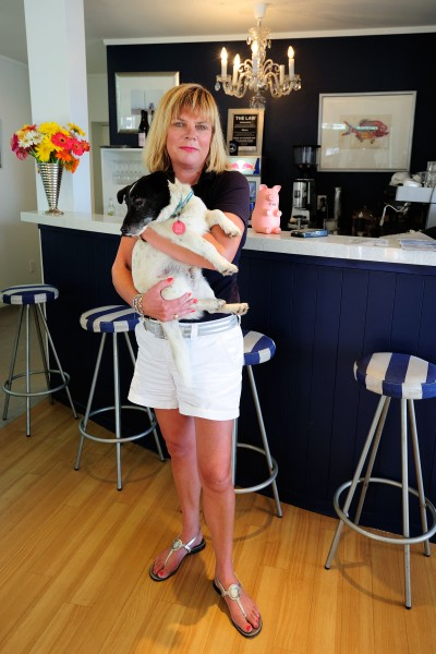 "Oneroa Fish and Chip proprietor Chanel Eagle holds Zinny in her restaurant. The eatery, she says, has a cult following with fish and chip aficionados that even extends offshore. ""One lady who's currently on a three week holiday from Britain eats with us every night."""