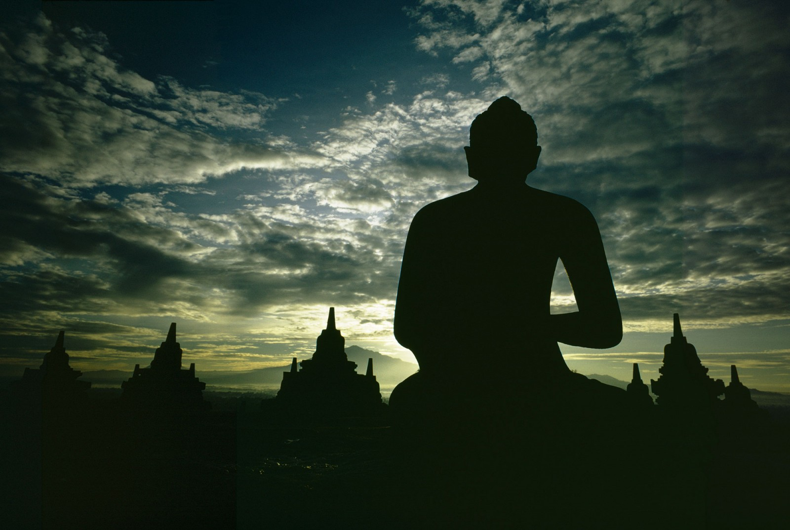 A statue of Buddha looks out over the perforated stupas containing similar icons at Borobudur in central Java 1971. Five hundred and four large Buddha statues adorn this 9th-century Indonesian monument.