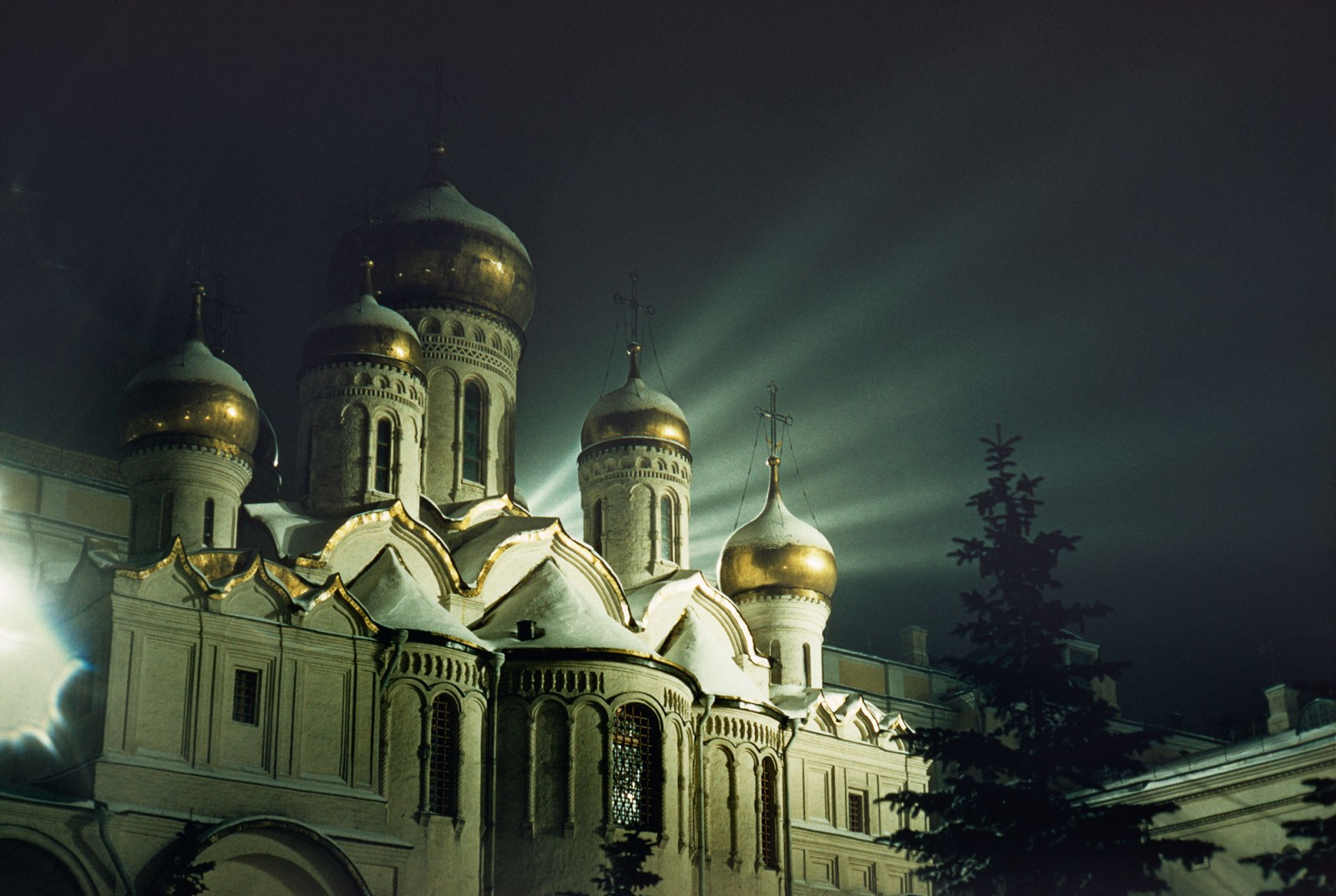 A church at the Kremlin glows eerily on a winter's night (top). Cartier-Bresson's landmark book The People of Moscow—released two months ahead of Brake's arrival in Russia—was compiled over a summer visit.
