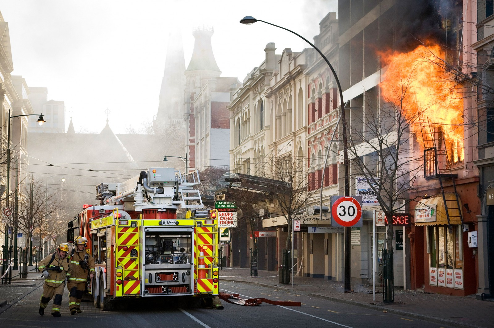Firefighters battle a blaze along Worchester Street after the 7.1 magnitude earthquake struck 30 km west of the city at 4:35 am. Civil Defence declared a state of emergency.