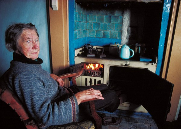 """Home on the Range—After 74 years on """"the hill"""", Welsh-born Dora Berdinner still cooks her meals, and warms her toes on the coal range of her Stockton home. The miner's widow was one of the few residents left in the once-thriving coal-mining settlement when I arrived there to photograph in 1994."""