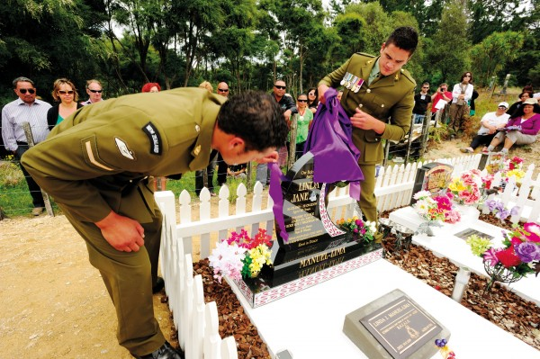 Two young Ngati Porou soldiers unveil the headstone of their deceased colleague, Sergeant Linda Jane Manuel Lima, as the Spanish cousins look on. Linda, a direct descendant of Manuel Jose, is buried at the urupa in Tikitiki's Poroporo Valley, along with other family members including Manuel Jose's daughter, Peti Lima.