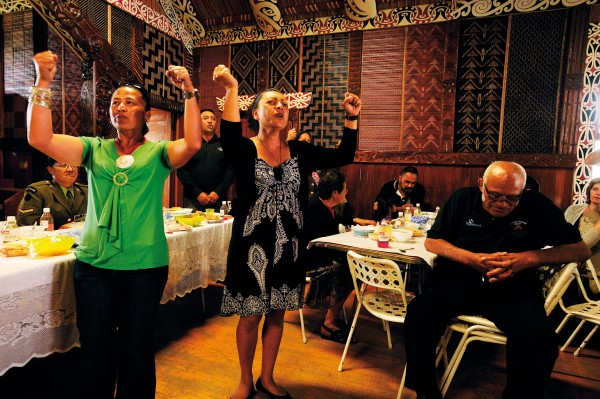 Singing and dancing erupted spontaneously throughout the Spaniards' visit to the east coast. At Te Rahui marae, two Paniora women sing in tribute to Linda Jane Manuel Lima at the hakari following the unveiling of her headstone. Kaumatua Big John Manuel (right) bows his head in respect.