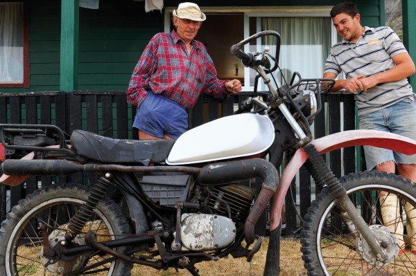 "Featherston resident Len Terry, left, has been frequenting his Ngawi bach since 1963. An avid fisherman and hunter, he was given a Yamaha 185 trial bike by a Ngawi resident 29 years ago. Now he is donating it to the third generation, Josh, with a long list of instructions to deal with the temperamental bike's many idiosyncrasies. However, he says, ""If you know what you are doing, she won't let you down."""