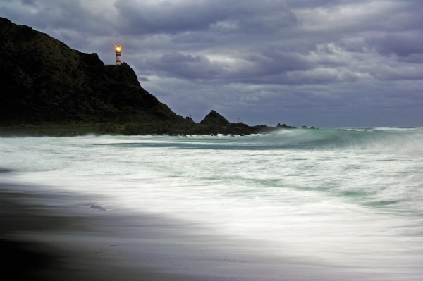Casting a frail loom during a storm, Cape Palliser lighthouse marks the southern-most tip of the North Island. Built in 1897,the light has been managed from a control room in Wellington since 1986.