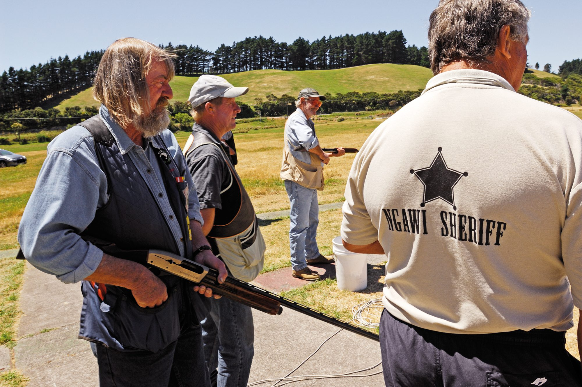 Like Hathawy, Garth Gadsby, president of local gun-club and self-described Ngawi Sheriff is a long-time resident. Having lost his own firearms license in a spate of vigilante action, he can now only supervise the skeet shooting.