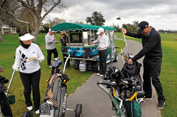 Pegasus's golf course is a drawcard not just for residents but for visitors from Canterbury and further afield. On a cool spring day an Australian foursome takes a break for hot food from a mobile pie cart.