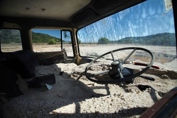 "The cab of an old Bedford truck, swamped by the floodwater, was filled to the brim. It had been a trustworthy workhorse on the farm since the early 1980s, around the time of the last major flood, after which Mike Robertson's father planted trees to help prevent land movement. The fourth-generation farmer's positive character has helped carry him through the ordeal, along with the essential network of family and fellow farmers. ""It's been tough at times, but I've coped fairly well. I've had to lean on a few people though—the load gets a bit heavy every now and then."""