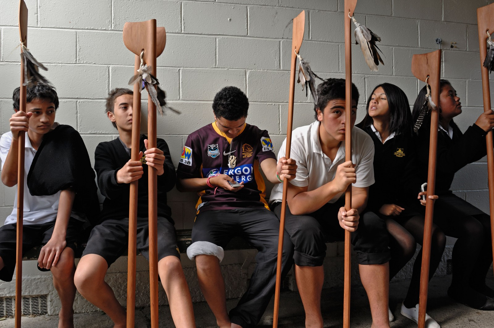 Students from Whakatane High School await their taiaha practice, part of a cohort of Maori in a population strongly biased toward youth. More than half of Maori will be under 30 in 2026. The relatively high working age population means they stand to reap an economic dividend if they can overcome the challenges created by long-standing structural inequality.
