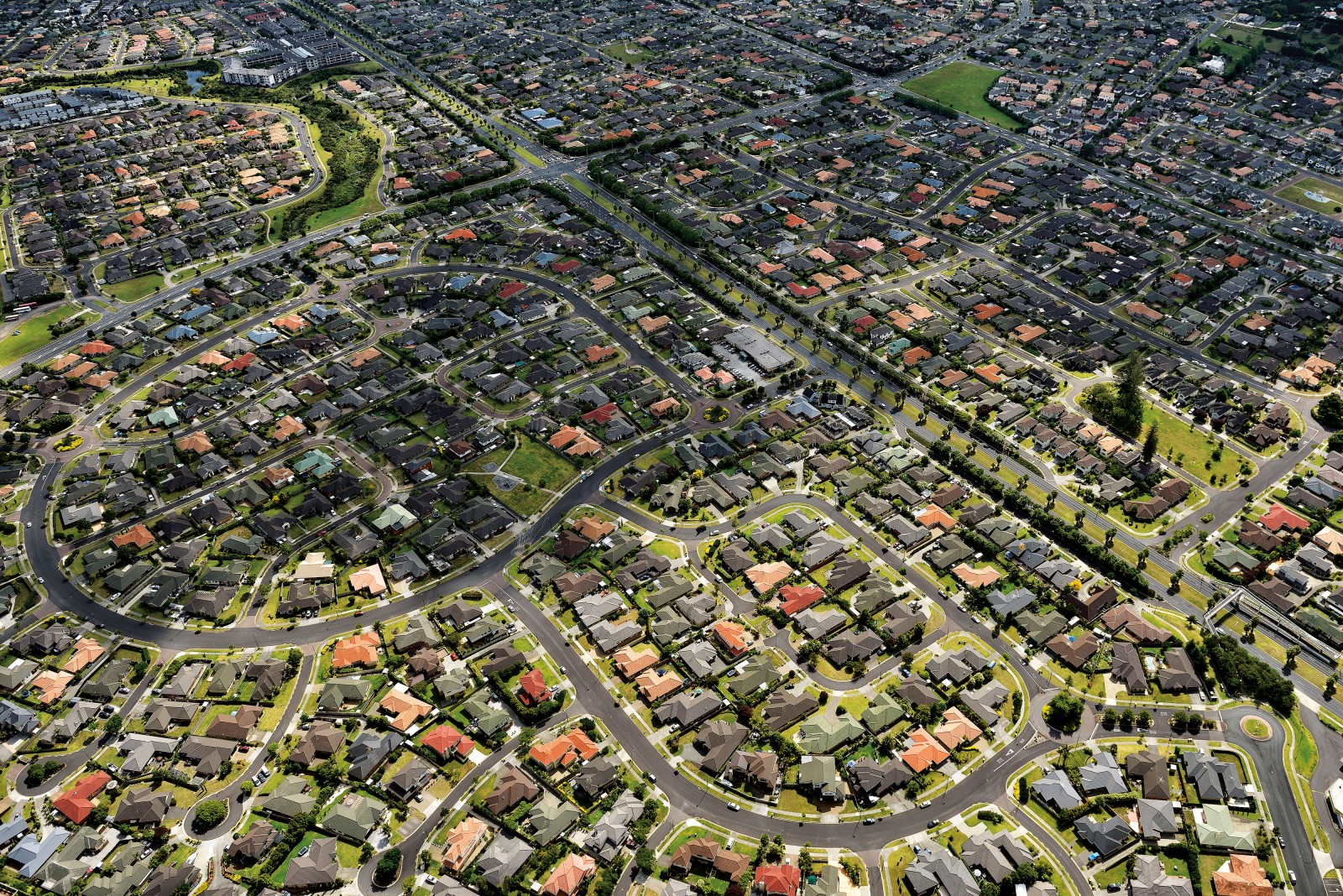 In 2001, the suburb of Flat Bush in Auckland's south-east was farmland; by 2025 it's expected to be home to as many people as Nelson. It echoes similar large-scale suburban developments at Albany in the city's north. The New Zealand Centre for Sustainable Cities is in the middle of a four-year project looking at the environmental and social impacts of such greenfields development, compared with more compact development alternatives closer to the city. Compact developments include smaller homes that cost less to heat, reduced distances between destinations, lower emissions, increased opportunities for exercise, lower healthcare costs and greater social cohesion.
