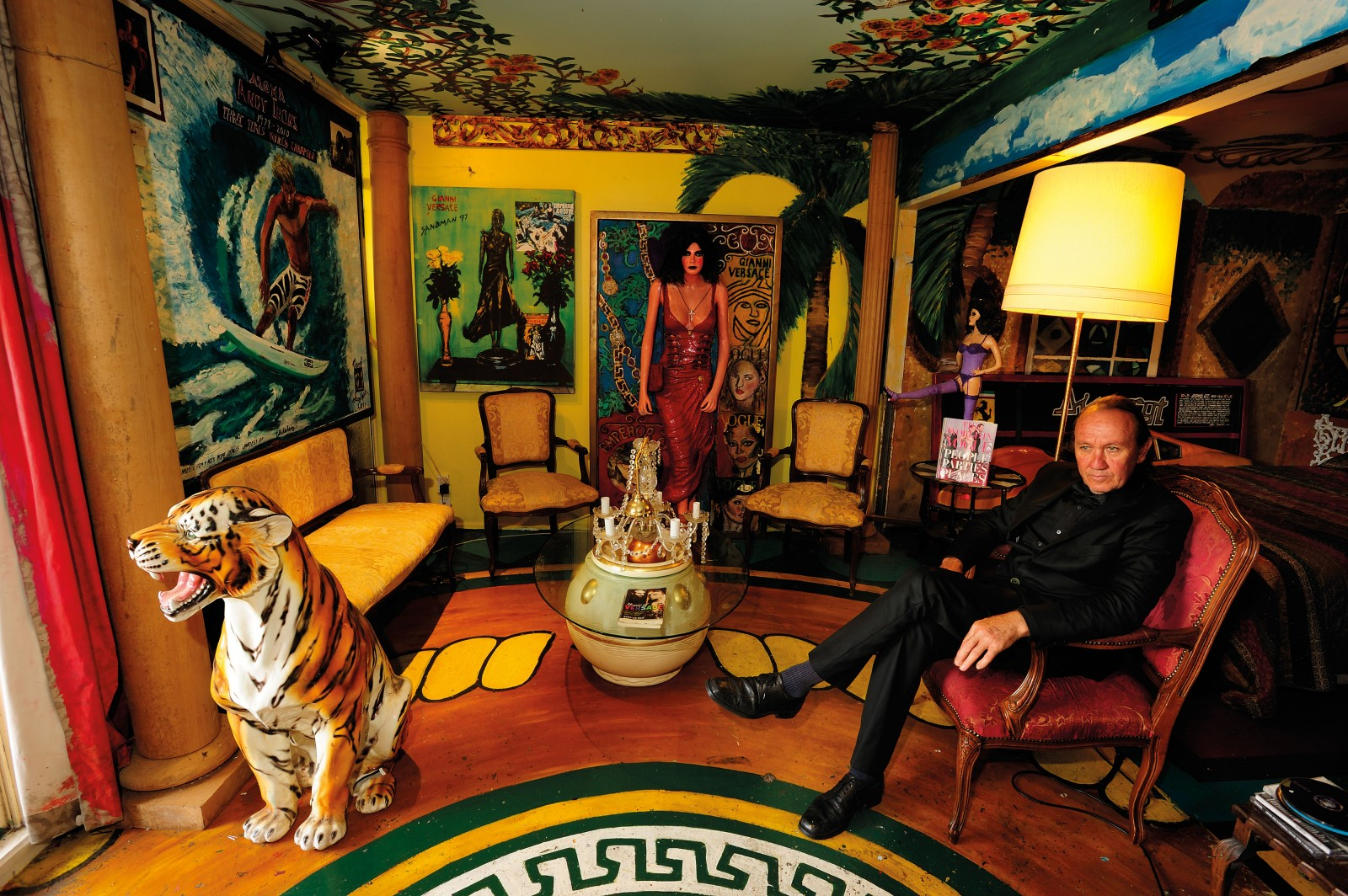 Artist and former competitive surfer Mark Sandman is surrounded by his three-dimensional Versace paintings and tribute to three-time World Surfing Champion Andy Irons, in his Knightsbridge apartment on K' Road.