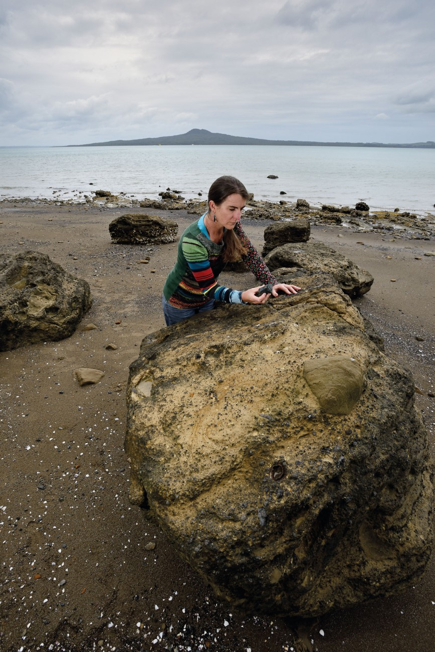 Devora co-leader Jan Lindsay examines tuff debris fallen from the cliffside Whakamuhu volcano in Ladies Bay, St Heliers. The volcano was small, but its succession of blast waves radiated outward at speeds in excess of 200 kilometres per hour. If that eruption occurred in 21st century Auckland it would close the Motukorea Channel to boats and ferries, and threaten the suburbs of Kohimarama, Mission Bay, St Heliers, Glendowie and Glen Innes. Auckland Civil Defence would oversee immediate evacuation within that three-kilometre radius and impose a danger zone for two kilometres beyond that, taking in Meadowbank, the northern slopes of Remuera and the Waitemata Harbour entrance.