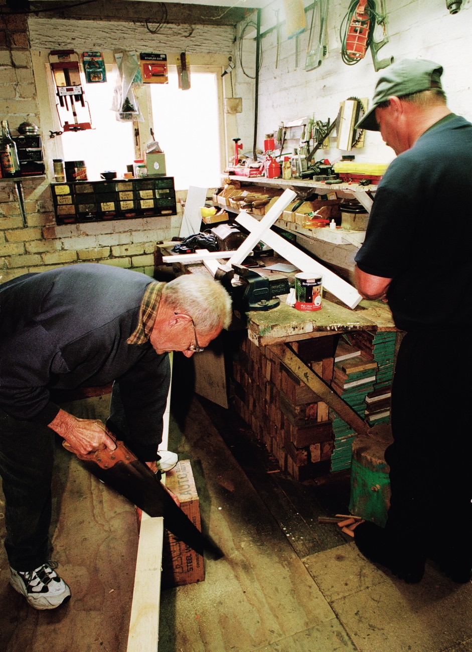 Alan Horrox, with his sons David and Bruce, makes crosses in the basement workshop of Alan's Huntly home.