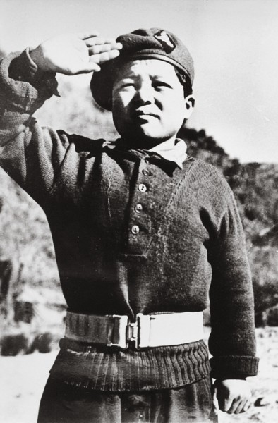 Korean orphans such as this 10-year-old were often looked after by the UN troops and adopted as mascots, becoming houseboys around the base.