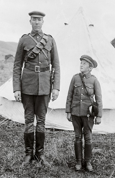 "More than 6000 New Zealand men served in South Africa, including the pair on the left: the tallest and shortest of the ""Rough Riders,"" the name adopted by the Third and Fourth Contingents."