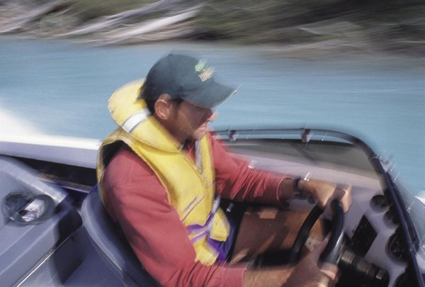 Fish and Game regional manager Ross Millichamp belts up the Rakaia by jet-boat to assess the progress of the run.