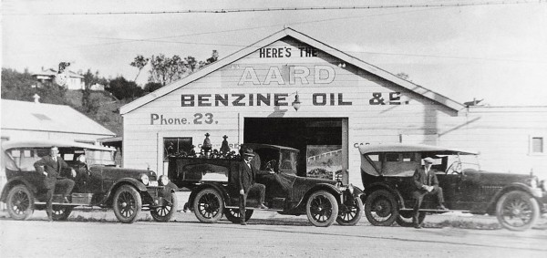 "Cars needed petrol—known as ""benzine""—and regularly broke down, so as stables and blacksmiths went out of business, garages proliferated. For many years petrol was distributed in four-gallon boxed tins, but in 1926 the first bulk petrol was imported. Annual registration and licensing of motor vehicles was introduced in 1924, allowing reliable statistics on vehicle numbers to be compiled for the first time. By 1929 the country boasted one car for every 10 people, an ownership rate exceeded only in North America."