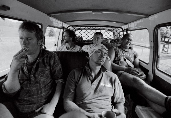 "The daily van ride home from the forest blocks to Hicks Bay, where the loggers stay, tends to be a quiet one—everyone's too tired to talk. Back at base, the men relax and phone families as far away as Rotorua and Pukehina. Crew boss Howard Skipps treats his men to ""five-star"" accommodation—at least in bushmen's terms—to compensate for the tough conditions in which they work."