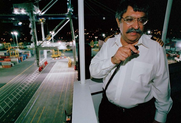 Captain Dipak Mohan of Contship Borealis gives instructions as his ship berths at Fergusson Wharf, Auckland's main container terminal, on her first voyage to New Zealand.