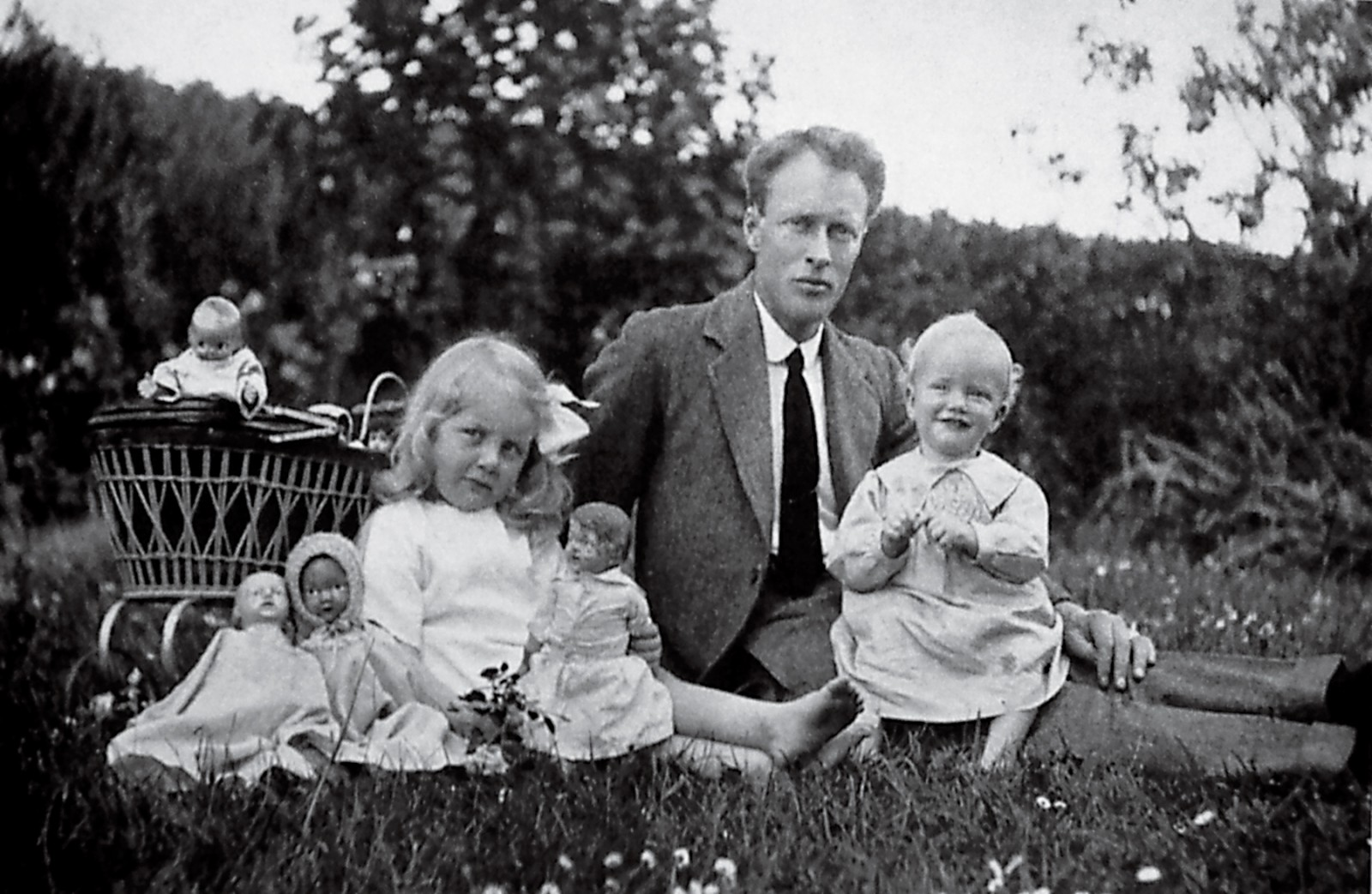 Maurice Wilkins, nearing his first birthday, is seated on his father's knee in Pongaroa, beside his older sister, Eithne. Although his family--which had emigrated from Ireland in 1913--left New Zealand permanently in 1923, Maurice Wilkins, now aged 87, retains fond memories of the country of his birth.