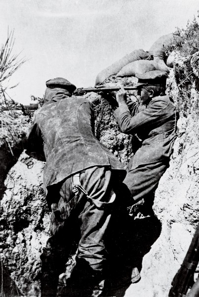 Turkish snipers, a severe menace in the early days at Anzac, were countered by men working in pairs. One would spot with a spyglass and wave a hat to draw fire and the other would shoot back.