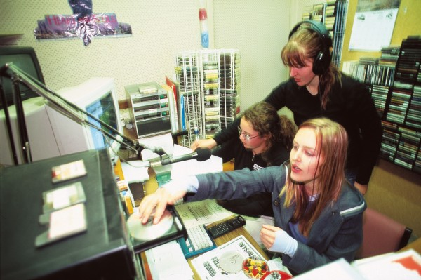Generation X music doesn't get much airplay on easy-listening Classic Gold Ranfurly--except when Wedderburn schoolgirls Edwina Dowle (left), Debbie Adamson (standing) and Shelly Adamson host their weekly rock show. The broadcast i one of the service activities the girls are undertaking as part of the Duke of Edinburgh's Award.