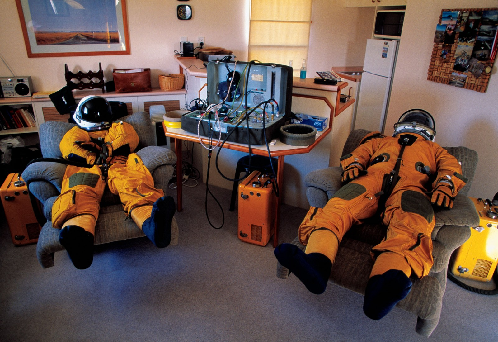 Extreme soarers venture far beyond the human body's atmospheric limits. In their bid to double the world high-altitude gliding record to 100,000 ft (30,500 m), Perlan Project pilots Steve Fossett and Einar Enevoldson must don NASA spacesuits (left). Respiration and perspiration inside the suits' hermetic embrace make it desirable to inflate and air them after use—treatment being administered here.