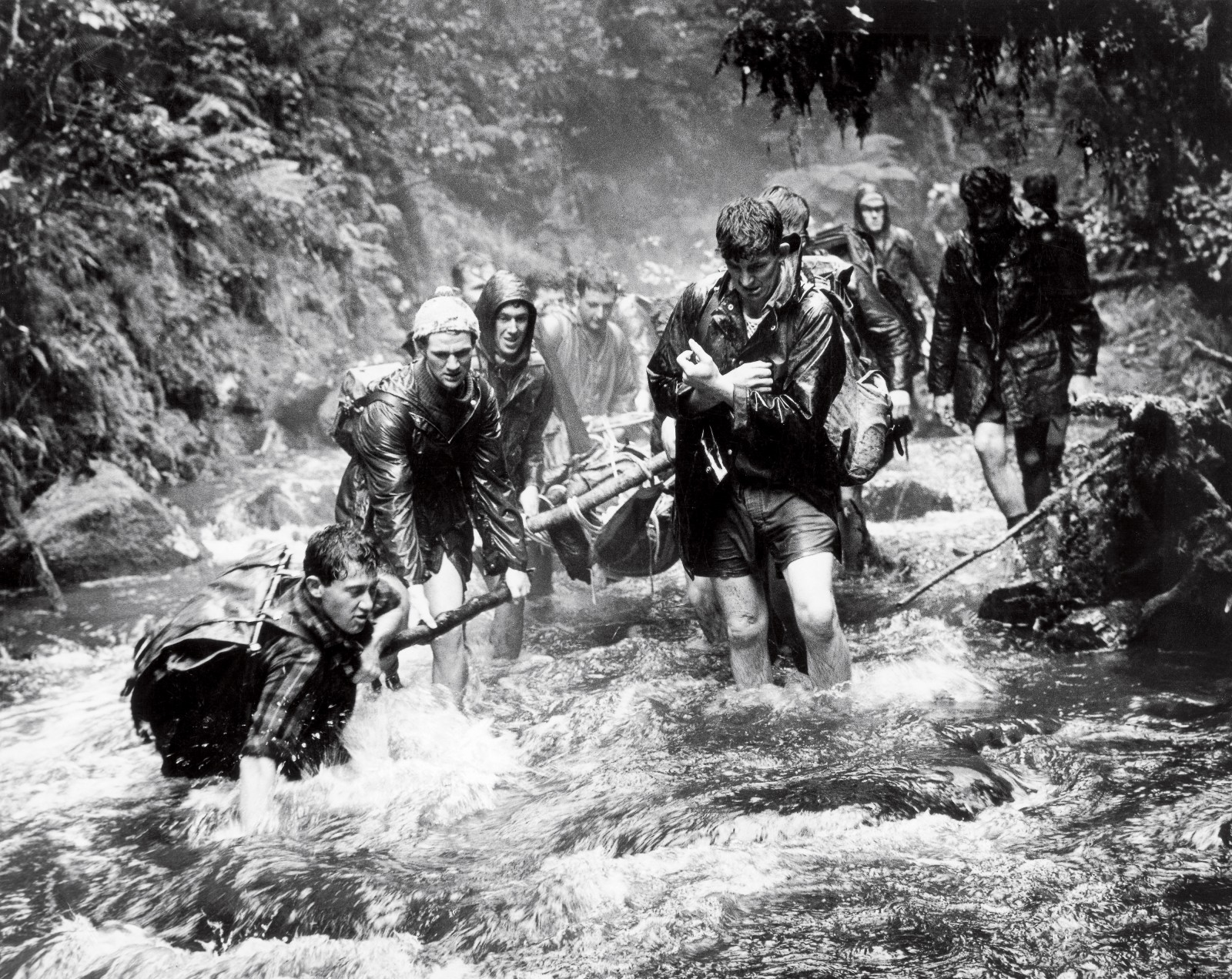 Men carry out the body of Peter Langer, who drowned in the Nga- tiawa Stream in 1964. Fifty-five people died in the Tararua Ranges between 1900 and 2003: drowning accounted for 23 and hypothermia for 14. There has also been one murder and an accident where a soldier blew himself up with a hand grenade during World War II. Before helicopters revolution- ised search and rescue from the 1960s onwards, tramping clubs performed this servic
