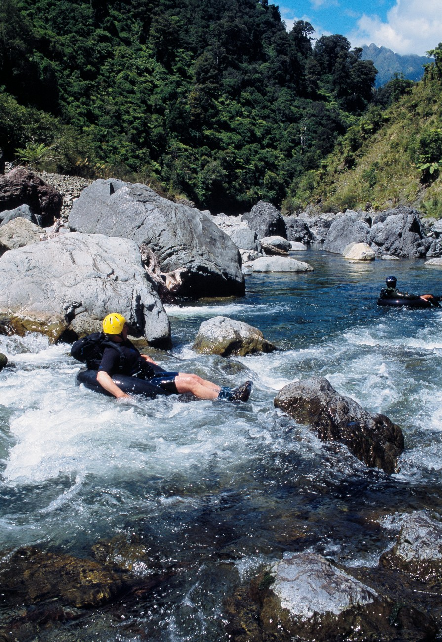 Tararua enthusiast and tramper Tony Gates tubing the Otaki River, with the Tararua Peaks in the distance. The Otaki is one of several Tararua rivers that feature gorges superbly suited to this sort of travel.