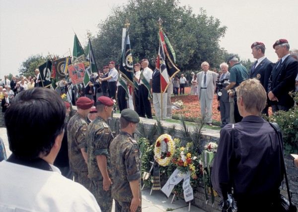 "To the strains of Rot Scheint die Sonne (""Red Shines the Sun"")—the Fallschirmjäger, or paratrooper, marching song—German veterans and serving paras honour their dead at the Soldatenfriedhof, or war cemetery, on Kavzakia Hill (Hill 107), above Maleme."