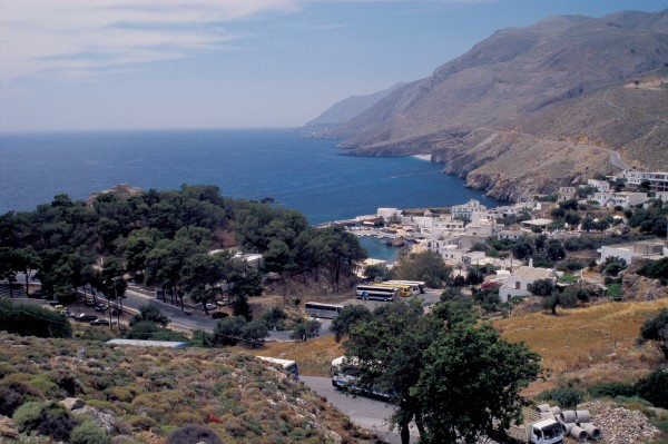 Nestled on the South Coast of Crete where the White Mountains plunge into the sea, the little settlement of Hora Sfakion isn't much larger today than it was 60 years ago, when the defeated Allied troops gathered anxiously on the surrounding slopes and beaches in the hope of evacuation by the Royal Navy.