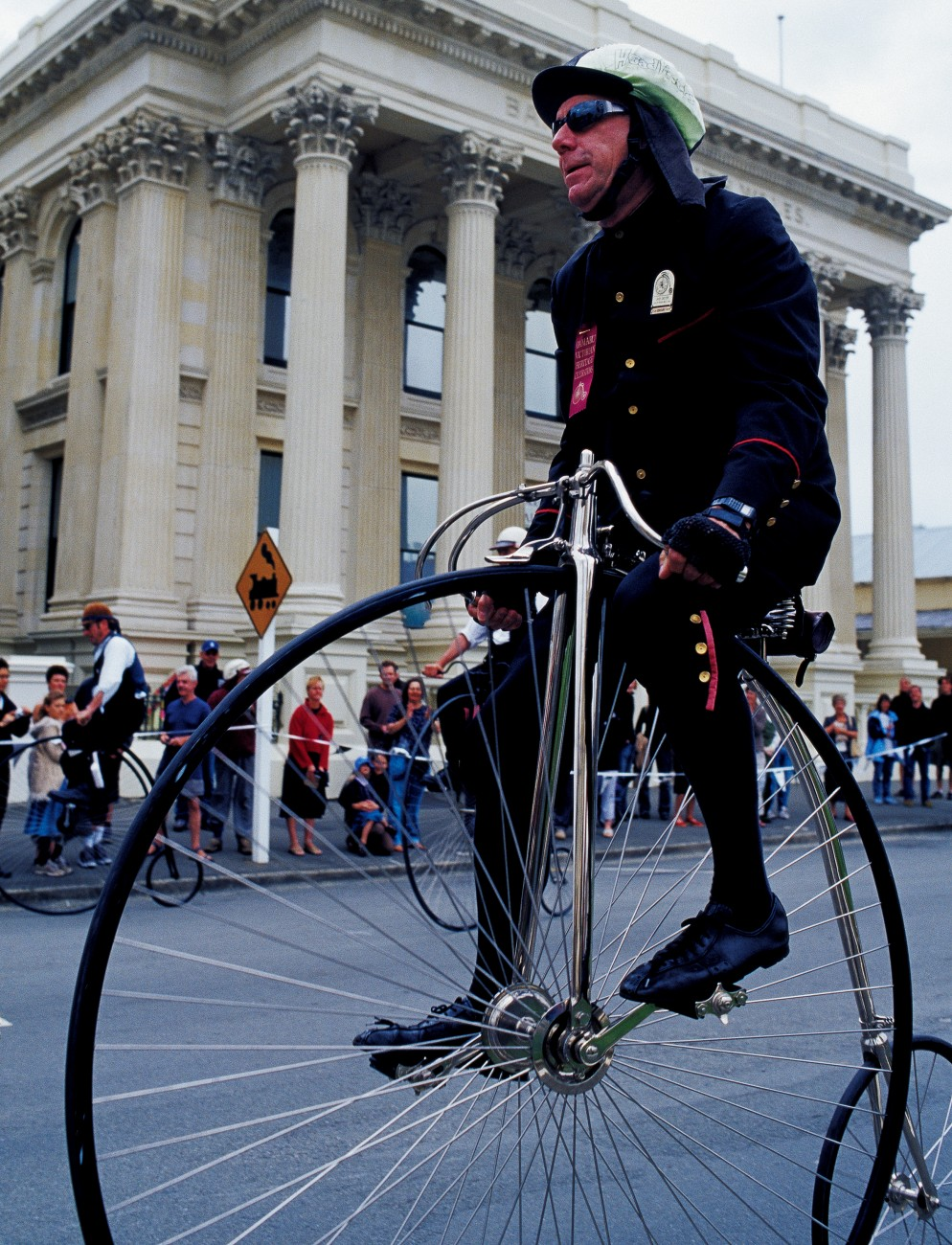 American Jack Castor takes on locals in a highlight of Oamaru's Victorian heritage celebrations—the national penny farthing championships. Castor cut his cycling teeth riding an 'Ordinary' from San Francisco to Boston in just 44 days. Here he takes rather less time outside the historic Bank of New South Wales (resplendent in its classical dress on previous pages).