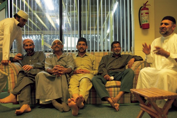 A band of brother in faith share a couch and companionship during Ramadan. IT's the first time they have eaten today, but a long night of driving awaits. For many here the taxi industry forms a critical stepping stone as they adapt to a new life in a new land.
