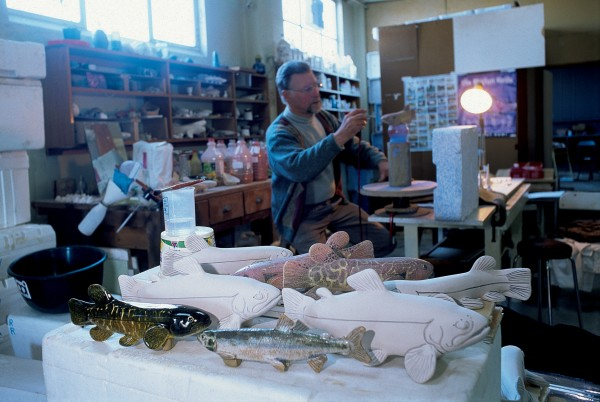 Former fisheries biologist Stan Woods now makes pottery figurines in his Dunedin workshop. His version of a grayling is the slim silver-grey fish in the foreground.