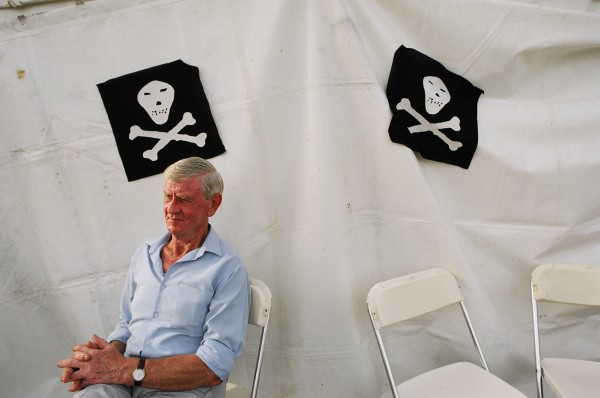 A fair warning of the brew's potency, the skull symbol is a relatively new addition to the mustique of the Hokonui, dating from Enwright's operation in the 1940s and '50s. On this day the skull and crossbones indicate the drinks tent.