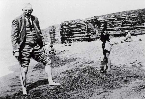 Rutherford tended to resemble an avuncular small town squire rather than the Nobel laureate and statesman of science he was. Here he is seen at the beach with his granddaughter in 1931, and outside a Welsh cottage (below).