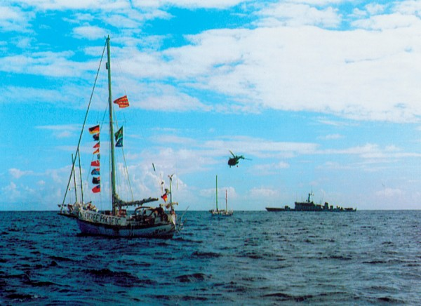 Peace flotilla yachts and Greenpeace plated cat and mouse games with French warships aircraft around the fringes of the 12-mile wide exclusion zone.