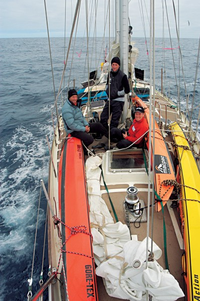 South Georgia Island lies 1000 nautical miles east of Cape Horn. Even in ideal conditions, it took six days sailing to reach. Mark Jones (left), Zac Shaw (yacht crew) and Marcus Waters (right) enjoy time on deck before hitting harsher weather near the Antarctic convergence.