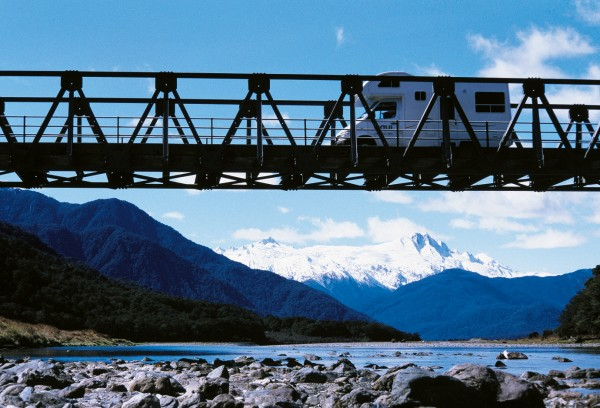 Coming from Central Otago, the road crosses the Haast River three times, the middle bridge lying not far above the river's confluence with the Landsborough, which rises west of The Hermitage. Rainfall in the mountains may exceed 8 m a year, and the district's rivers drop 50 million tons of rock a year into the sea.