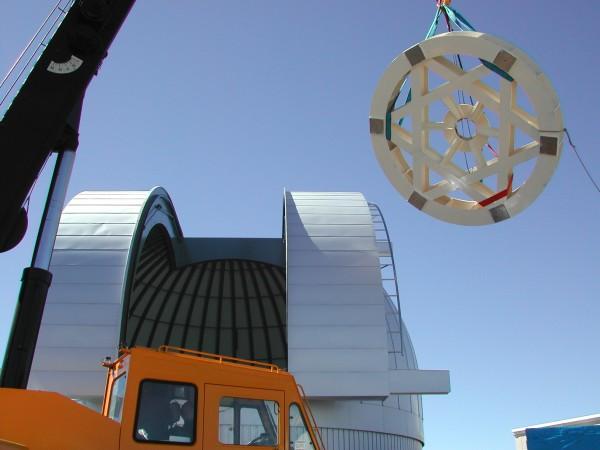 (iii) Takashi Sako and Tomohiro Sekiguchi assemble the telescope's camera at Nagoya University.