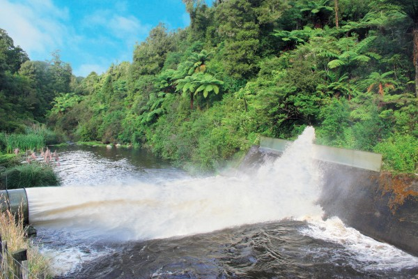 Water gushes from Cosseys Dam, a monthly environmental requirement of the water resource consent.