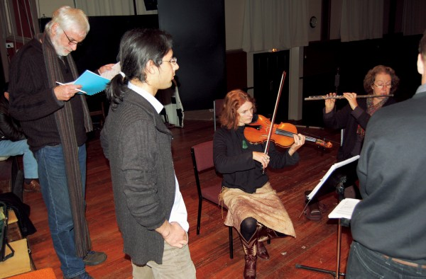 Composer Ross Harris follows the score of visiting Italian composer Stefano Muscaritolo while his piece is being played by an ad hoc ensemble, including Miranda Adams (violin) and Ingrid Culliford (flute), at the Nelson Composers' Workshop.