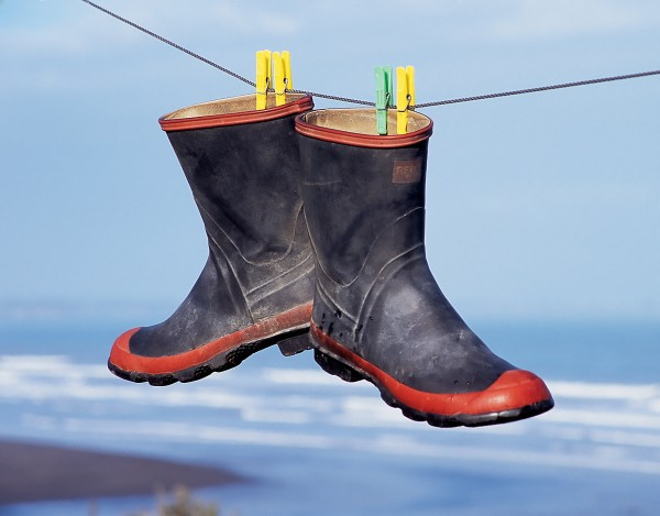 Gumboots are not generally noted for their delicate linings, so there is no reason why they can't be sluiced out and hung up to dry.