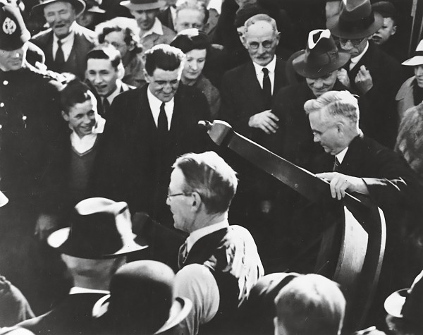The PM, Michael Savage, and other ministers carried furniture into Labour's first state house in Miramar in 1937, and state housing was a plank of Labour's 1938 election campaign.