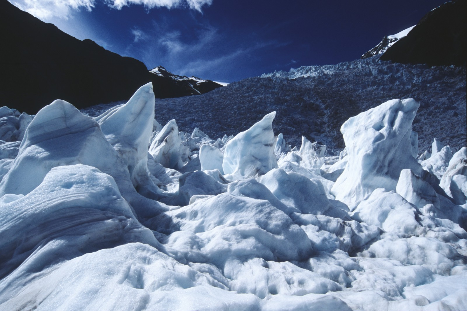 The elements have sculpted these pinnacles—seen against the backdrop of the main icefall—from large blocks of ice.