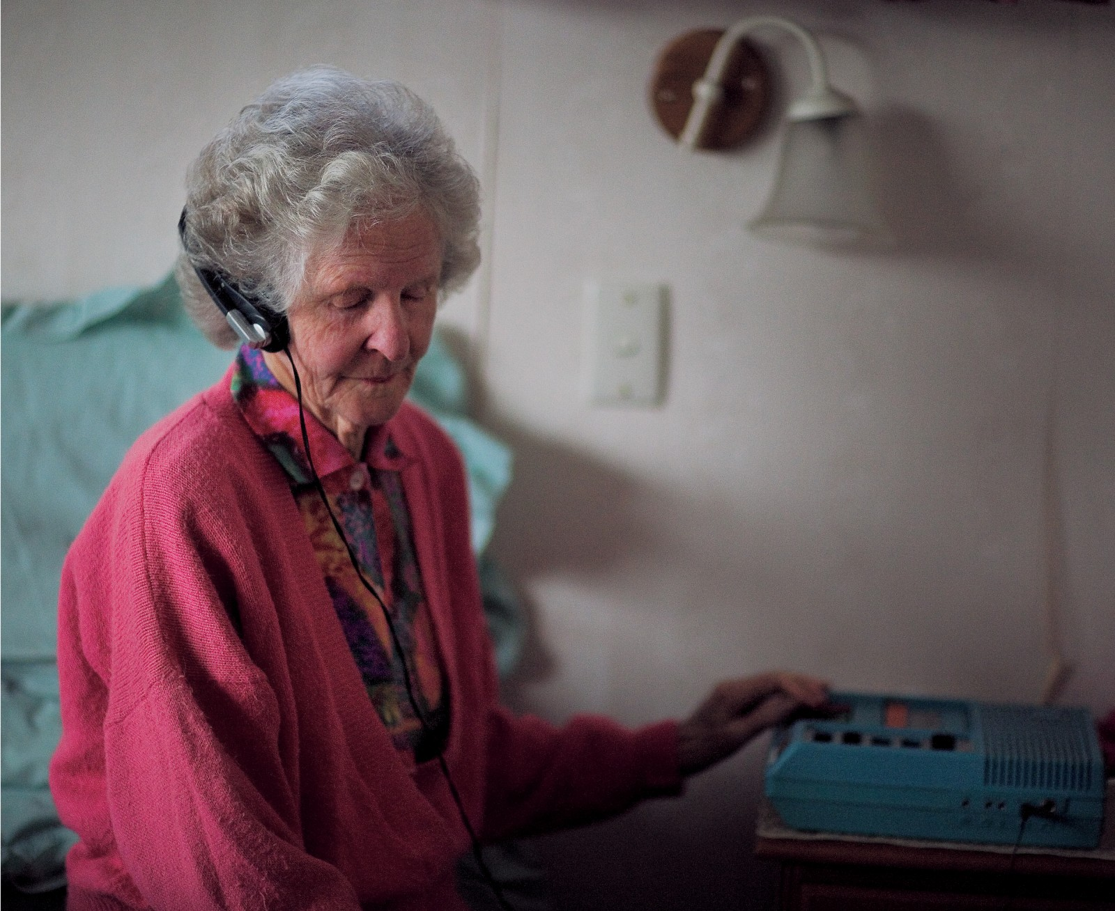 Inveterate reader of talking books, Aileen Carrington, has played literally thousands of books through her special foundation cassette player (blue). The players are deliberately clunky with large, brightly coloured controls so those with residual sight and arthritic fingers can operate them more easily.
