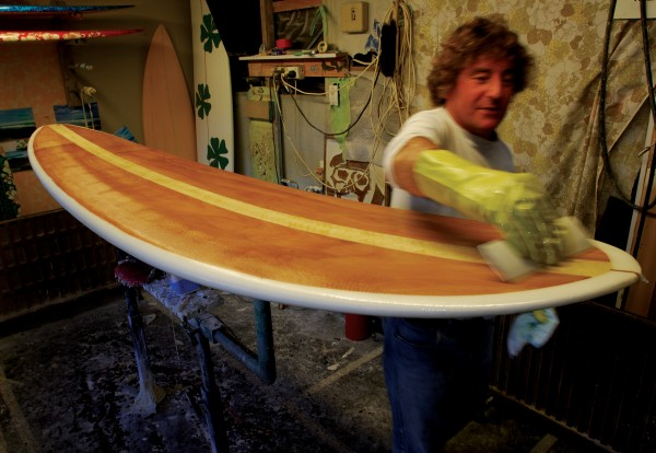 Local surfer Paul Shanks fibre glasses his Special Forces brand of surfboard which boasts a kauri and woven bamboo laminated deck.