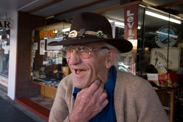 "John (upper, left) and Karam Haddad, long time retailers in Otorohanga, have created their own line of ""all-year-round-hats"", one of which is worn by local country and western singer Merv Haines (bottom)."