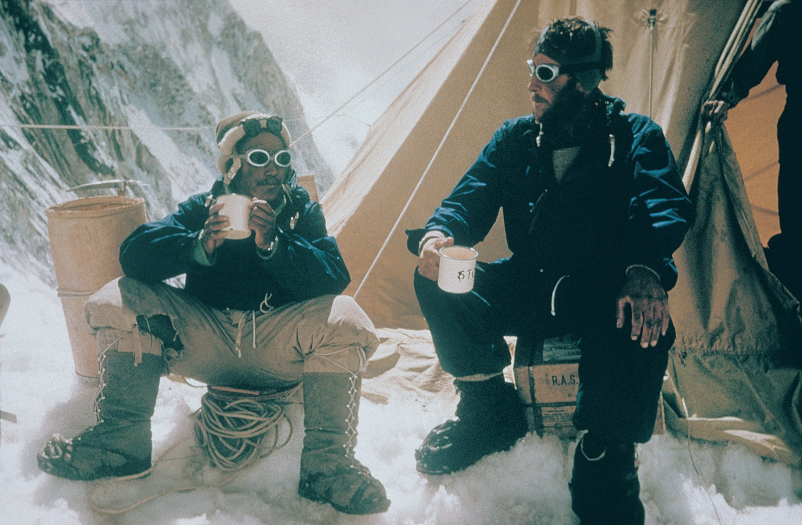 Tenzing and Hillary—just after standing on the highest mountain in the world, and just before being catapulted into the international spotlight—celebrated their impressive achievement in time-honoured British fashion with a mug of tea.