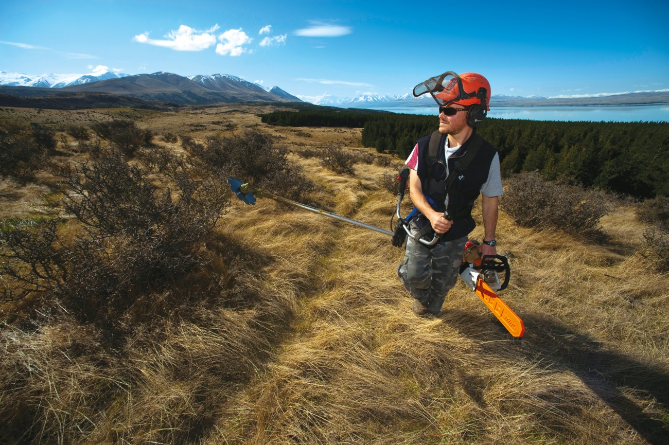 "Ethan Gabriel mops up wilding seedlings on Pukaki Downs Station. ""I really like trees—they're beautiful things, living things. These are just in the wrong place. If I thought too much about how they've spread all over the place, it would do my head in."""
